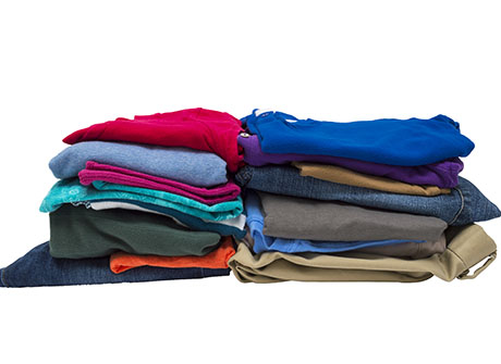 Two Stacks Of Folded Clothes Isolated On White